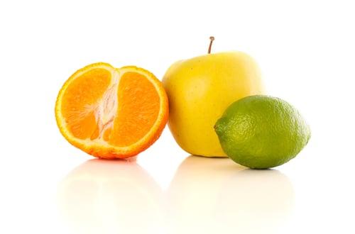 image of fruit: orange, apple, lime