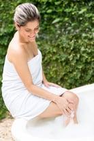 Beautiful woman taking a hot bubble bath-1