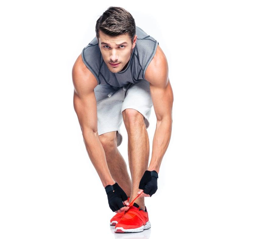 man putting on running shoes