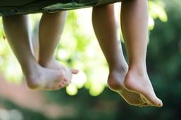 Happy children sitting on green grass outdoors in summer park-2